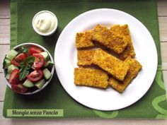 Questi gustosi bastoncini di tofu croccanti vegani e senza glutine sono un'ottima idea per un secondo sfizioso. Sono cotti in padella con pochissimo olio!