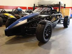 The Ariel Atom a roller coast on four wheels, or as close as you can get to flying, while on the ground.  It is powered by a naturally aspirated Honda motor, or a supercharged, or now a turbocharged version of the Honda power plant.  They also came with Chevy Ecotec motors in the past.   The Atom was once a performance bargain at around 35 thousand dollars.  No so anymore.