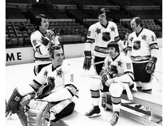 A group of future NHL Hall of Famers await a team photo before a All-Star Game. From left: Brad Park goalie Eddie Giacomin and Canadiens' Serge Savard Guy Lapointe (sitting) and Yvan Cournoyer. Rangers Hockey, Hockey Goalie, Hockey Games, Ice Hockey, Brad Park, Nhl, Goalie Mask, Vancouver Canucks, New York Rangers