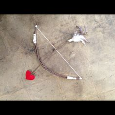 Homemade bow and arrow for a Cupid photo shoot! ...made by @deidre for miller!!!