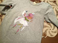 hada pintada en una camiseta con detalles para darle relieve