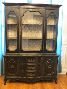 Black French Provincial china cabinet