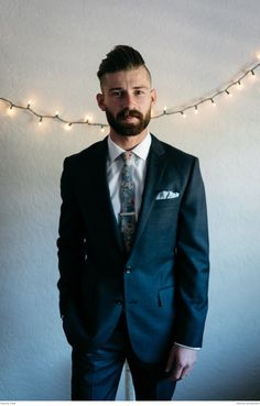 Classic black suit with a floral tie | Photograph by Joel Bedford | Real weddings