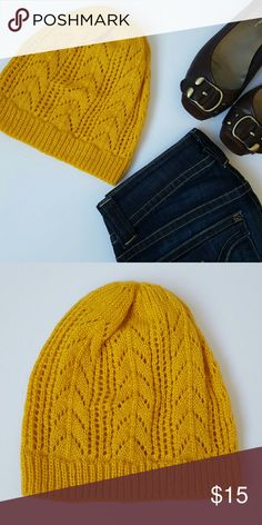 """Amber Yellow Pointelle Knit Hat Stay worm and look adorable in this beautiful pointelle knit hat. Perfect for Fall! Brand new without tags. Never worn. Perfect condition. Measures 9"""" from top point to bottom. Measures 9"""" across bottom. Accessories Hats"""