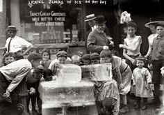 """Heat wave in New York. July 6, 1911. """"Licking blocks of ice on a hot day."""""""