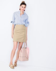 J.Crew classic with a twist: The scalloped skirt. We made our flattering mini in a faux-wrap silhouette with pretty scalloped details. Now that's something you don't see every day.