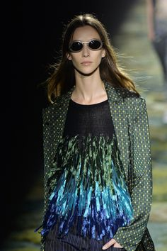 We're mesmerised by the innovative appliqué and goggle like glasses seen at the incredible@DriesVanNotenshow. #SS15 #PFW