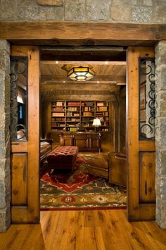 A 'traditional' barn door as an interior door looks great--but they're becoming a bit overused. Consider pocket doors instead, and frame the door as a barn door--with the usual crossbeams and pulls--but use very heavy, beveled glass for the solid part of the door.