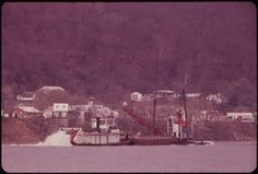 A boat passes a barge on the Kanawha River in Towns In West Virginia, West Virginia History, West Va, Mountain States, Old West, 1970s, Country Roads, Boat, River