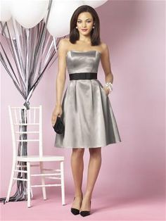 Dessy - After Six 6629:  matte satin with black grosgrain ribbon - pleated full skirt with pockets.  Dress color is taupe.