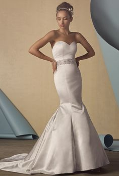 Brides: Alfred Angelo. Strapless satin gown with a sweetheart neckline, fit and flare silhouette. The natural waist has been embroidered and encrusted with a dramatic beaded trim. The dramatic flared skirt leads into a chapel length train. Also available without the beaded waistband as style 2434NB.
