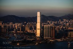 Catching the Sunset - This prominent building is the tallest in Hong Kong with 484m height. It stands on completely on artificial land surrounded by commercial and residential apartments and near West Harbour Tunnel which connects motherland with Hong Kong Island.