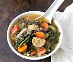 Hearty Soups With Superfoods: Kale, Quinoa and Black Bean Soup With Italian Sausage. See the full recipe here! #SelfMagazine