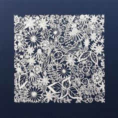 """Original Paper Cut Artwork Densely patterned in crisp white and indigo, """"Summer Indigo"""" is a perfect for adding texture and interest wherever it is displayed. The artwork is hand cut from a single she"""