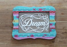 "Papercut art quote in an unique colorful frame; ""Dream""."