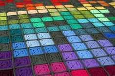 fun crocheted blanket. Love all of the bright and happy colors... would look great with monochrome or analogous colors too!