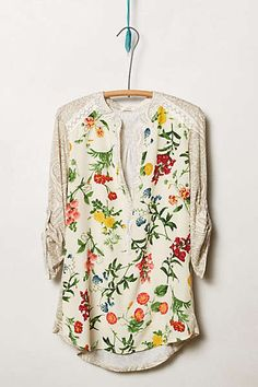 I love the print, lace and style of this springy top.