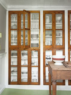 Built in wood & glass lockers as a display cabinet. would be nice if the bottom half were drawers or frosted glass