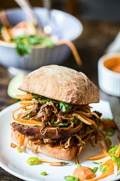 Asian pulled pork buns with carrot, zucchini and radish slaw