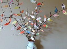 takken met blaadjes van papier Door Merryfish