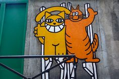 Remaining anonymous until his arrest in 2007, Thoma Vuille aka Mr. Chat, painted his happy cats all over the walls of France. Reminiscent of the Cheshire cat grin, these cats were seen running, bouncing, and waving from rooftops to train platforms.