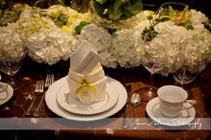 Our Designs For The 2012 Portland Convention Center Bridal Show. An Elegant and Sophisticated Centerpiece.  Coordination by Encore Events, and photograph by David Barss Photographer. #WeddingCenterpiece #Flowers