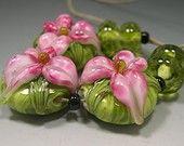 HANDMADE LAMPWORK BEADS Earrings Pair Donna Millard sra Spring Fresia pink green lily flower earring. $15.00, via Etsy.