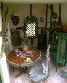 The Fantasy Forest: The Sage Fairy House ~ Julie McLaughlin...I have some of that hardware cloth that could make a cute window like the one pictured here.