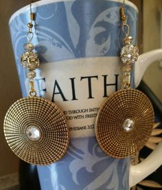 Gold bling alloy carved round dangle earrings.