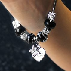 This 18cm Heart charm bracelet comes with these black and white charms that you simply twist on to the bracelet to make any design you like!  This Bracelet comes with a Butterfly