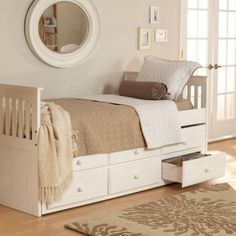 Find it at the Foundary - Ethan Trundle Mission Bed - White $429 plus 10.95 shipping.  Twin-size pine wood trundle bed  White finish  3 storage drawers  3 decorate drawer fronts  Trundle bed requires mattress up to 6-inches-thick  Mattresses and bedding are not included  Recommended for children 6 years old and up  Accommodates up to 180 pounds  Dimensions: 80L x 41W x 38H inches  Final Sale item - not eligible for return  Whats Not Included: Mattresses, Bedding mbutterworth