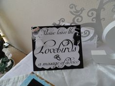 I decided to do lots of DIY for my engagement party.  This is a sign I made to ask guests to write a message of advice on a note pad for the 'lovebirds' (Bride & Groom) that we got to read when everyone had left. Very nice memory!