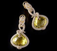 Citrine Snake Earring Citrine snake earrings with Diamonds, Rubies and Sapphires set in 18K gold.