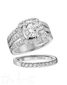 14KT WHITE GOLD CARO74 1.3 DTW ENGAGEMENT RING *Drop in platinum peg setting *unique micro prong diamond setting *flush set kiss diamond. (I would love it with one less band)