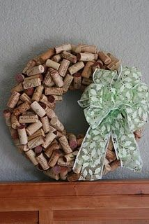 cork wreath with a thick ribbon bow. Looks like it could be tricky to make but what a cute gift for the holidays. Is there somewhere you can buy corks in large amounts lol?