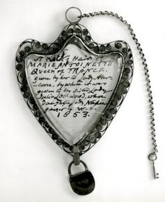 This locket was made complete with key and mini lock.  The locket is somewhat heart shaped, with a delicate filigree design in thin metal along the edges.  What almost looks like a cut crystal is hinged at the top and secured by the lock. Inside is a blond lock of hair and note that reads:    A lock of hair of MARIE ANTOINETTE, Queen of FRANCE given by her to Lady Abercorn by whom it was given to her sister Lady Julia Lockwood, whose daughter Lady Napier gave it to W.S. 1853