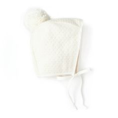 Your babe will be cozy and warm out in the cold with our 100% wool bonnet in Snow. With this sweet bonnet on your babe's head, the only thing that will be melting this winter will be your heart. Bonnet is fully lined 100% Pima cotton and trimmed with ultra-soft cotton. Pom is 100% Merino wool.**Sherpa lining NOT available with this bonnet**Care instructions:Spot clean outer || Hand wash Do not machine wash