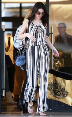 Kendall Jenner has legs for days in this amazing striped jumpsuit!