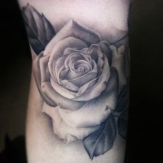 Rose tattoo but on my thigh.