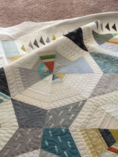 I recently quilted an Octagon Shimmer quilt for a local client. This pattern is designed by Jennifer Sampou. I emphasized the octagon shapes by randomly quilting designs in a radiating octagon.I used a Mark B Gone pen to draw boundary lines and then quilted in between with varying designs. I would suggest using a size… ReadMore