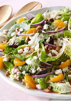 Fabulous Fruit & Feta Salad – Tart, sweet fruit and tangy feta cheese are tossed with greens, red onions, walnuts and reduced-fat raspberry vinaigrette for a refreshing side salad.