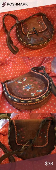 Genuine Leather Tribal Boho Bag Very nice tribal,  hippy bag with hand tooled leather design work.  Very good condition,  looks like it was not used.  It looks cool,  cause you are hip and uptown funky ! Vintage Bags