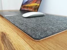 Dark Grey Wool Felt mouse pads that fit both a small or large desk and give you more than enough surface area for your mouse to work comfortably. Handcrafted from premium 100% Wool Felt with internal layer of padding for extra comfort and 2mm natural cork as a base.