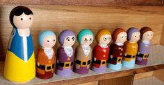 """The beautiful Snow White and her faithful seven dwarfs. They truly go together like peanut butter and jelly. Each piece is hand painted,  and sealed for protection and long life. This is a Large peg set, with Snow White measuring at 3.5"""" tall, and each dwarf is 2.25""""."""
