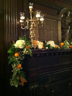 orange + magnolia leave garland for the mantle at a rehearsal dinner