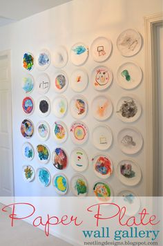 Kid's art gallery using paper plates. Love the dimension it brings to the wall!