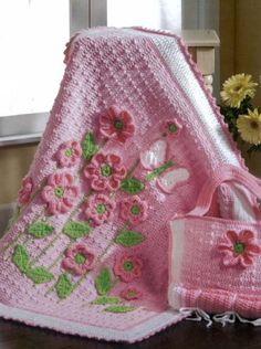 Crocheted pink floral baby afghan from Precious Designs for Baby by Mary Maxim.