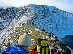 Walkers on Striding Edge, with Helvellyns summit in the distance