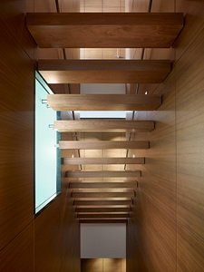 Floating wooden staircase, Hinsdale House, by Wheeler Kearns Architects