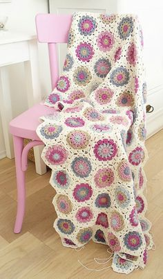 Crochet blanket on a painted pink chair. No pattern here. I pinned because I love the color combo.